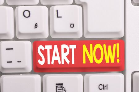 Writing note showing Start Now. Business concept for do not hesitate get working or doing stuff right away White pc keyboard with note paper above the white background