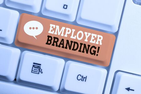 Text sign showing Employer Branding. Business photo showcasing promoting company employer choice to desired target group White pc keyboard with empty note paper above white background key copy space Reklamní fotografie - 130032692