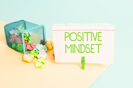 Text sign showing Positive Mindset. Business photo text mental attitude in wich you expect favorable results Trash bin crumpled paper clothespin empty reminder office supplies tipped Stock fotó