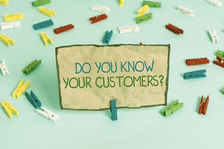 Handwriting text writing Do You Know Your Customers question. Conceptual photo asking to identify a customer s is nature Colored clothespin papers empty reminder blue floor background office pin Foto de archivo - 130032998