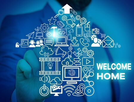 Word writing text Welcome Home. Business photo showcasing Expression Greetings New Owners Domicile Doormat Entry Male human wear formal work suit presenting presentation using smart device Banco de Imagens - 130035338