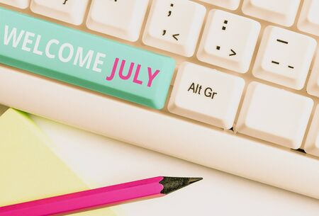 Handwriting text Welcome July. Conceptual photo Calendar Seventh Month 31days Third Quarter New Season White pc keyboard with empty note paper above white background key copy space Reklamní fotografie - 130039879