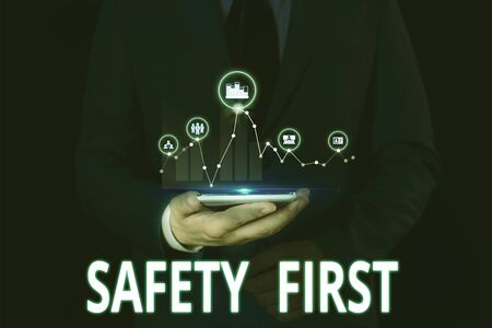 Text sign showing Safety First. Business photo showcasing Avoid any unnecessary risk Live Safely Be Careful Pay attention Male human wear formal work suit presenting presentation using smart device