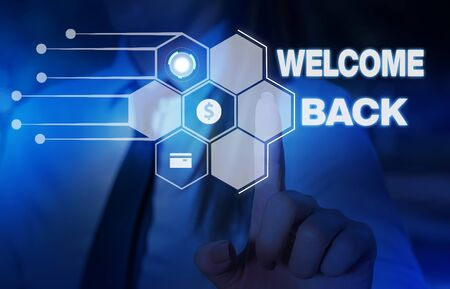 Word writing text Welcome Back. Business photo showcasing Warm Greetings Arrived Repeat Gladly Accepted Pleased Woman wear formal work suit presenting presentation using smart device Imagens