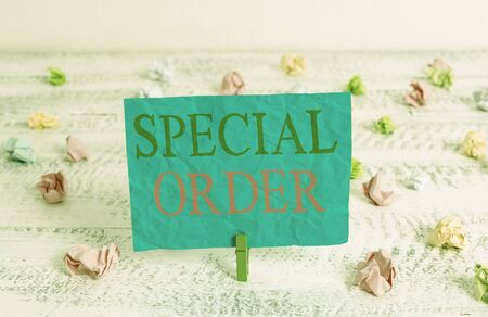 Word writing text Special Order. Business photo showcasing Specific Item Requested a Routine Memo by Military Headquarters Green clothespin white wood background colored paper reminder office supply Reklamní fotografie