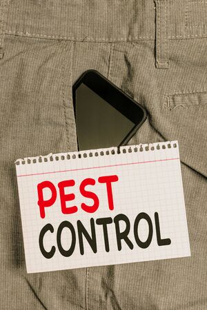 Handwriting text Pest Control. Conceptual photo Killing destructive insects that attacks crops and livestock Smartphone device inside formal work trousers front pocket near note paper Archivio Fotografico - 130040718