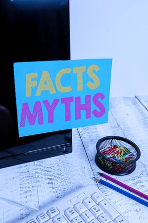 Writing note showing Facts Myths. Business concept for work based on imagination rather than on real life difference Note paper taped to black computer screen near keyboard and stationary