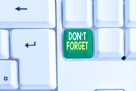 Conceptual hand writing showing Don T Forget. Concept meaning Know by Heart Think Back Fix in the Mind Refresh Memory White pc keyboard with note paper above the white background