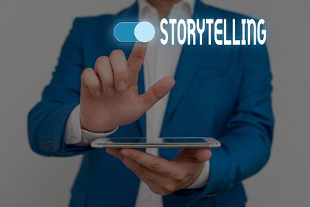 Word writing text Storytelling. Business photo showcasing social and cultural Activity with Theatrical Gestures Male human wear formal work suit presenting presentation using smart device