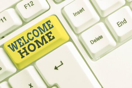Handwriting text Welcome Home. Conceptual photo Expression Greetings New Owners Domicile Doormat Entry White pc keyboard with empty note paper above white background key copy space