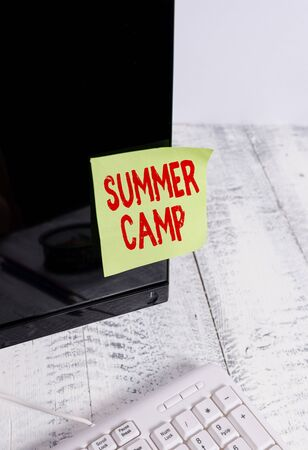 Word writing text Summer Camp. Business photo showcasing Supervised program for kids and teenagers during summertime. Notation paper taped to black computer monitor screen near white keyboard