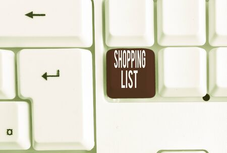 Writing note showing Shopping List. Business concept for Discipline approach to shopping Basic Items to Buy White pc keyboard with note paper above the white background