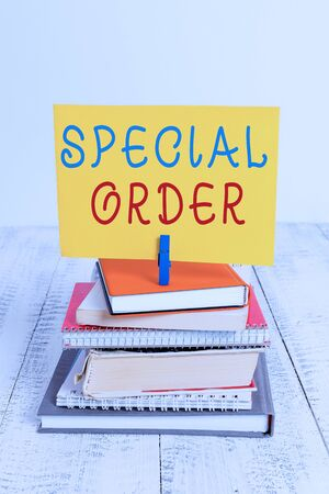 Conceptual hand writing showing Special Order. Concept meaning Specific Item Requested a Routine Memo by Military Headquarters pile stacked books notebook pin color reminder white wooden