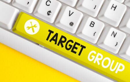 Conceptual hand writing showing Target Group. Concept meaning Particular showing that an advertisement intended to reach to White pc keyboard with note paper above the white background Reklamní fotografie