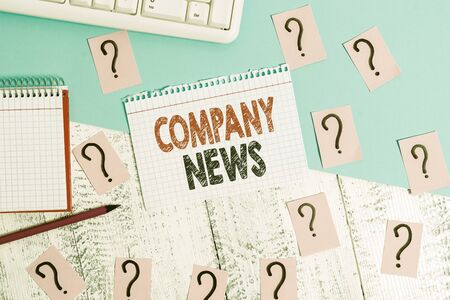 Text sign showing Company News. Business photo showcasing Latest Information and happening on a business Corporate Report Writing tools, computer stuff and math book sheet on top of wooden table
