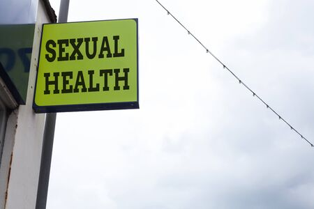 Word writing text Sexual Health. Business photo showcasing Healthier body Satisfying Sexual life Positive relationships Green ad board on the street with copy space for advertisement