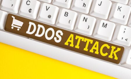 Word writing text Ddos Attack. Business photo showcasing perpetrator seeks to make network resource unavailable White pc keyboard with empty note paper above white background key copy space