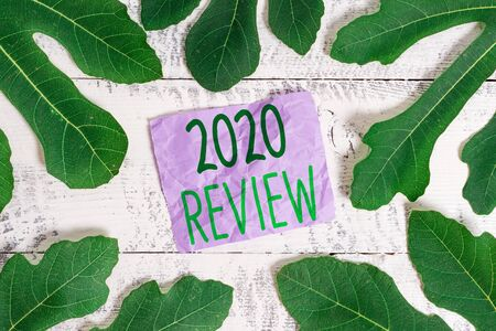 Word writing text 2020 Review. Business photo showcasing seeing important events or actions that made previous year