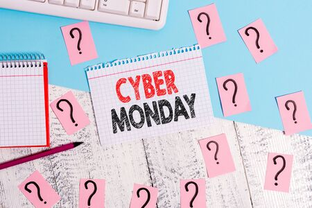 Text sign showing Cyber Monday. Business photo showcasing Marketing term for Monday after thanksgiving holiday in the US Writing tools, computer stuff and math book sheet on top of wooden table Stok Fotoğraf