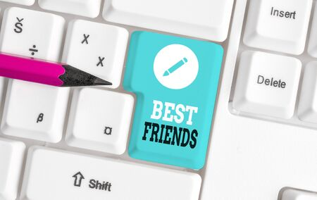 Word writing text Best Friends. Business photo showcasing A demonstrating you value above other demonstratings Forever buddies White pc keyboard with empty note paper above white background key copy space