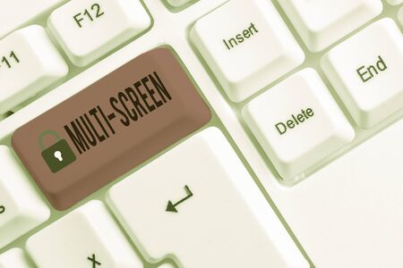 Conceptual hand writing showing Multi Screen. Concept meaning Having or involving several screen especially in a cinema White pc keyboard with note paper above the white background