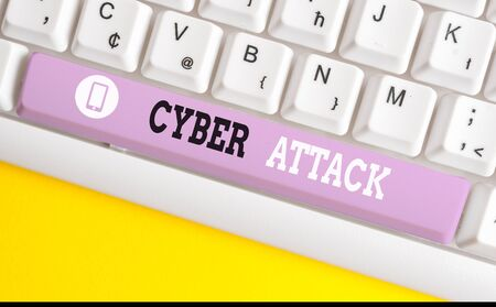 Conceptual hand writing showing Cyber Attack. Concept meaning An attempt by hackers to Damage Destroy a Computer System White pc keyboard with note paper above the white background