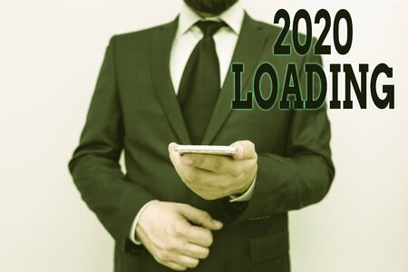Handwriting text 2020 Loading. Conceptual photo Advertising the upcoming year Forecasting the future event
