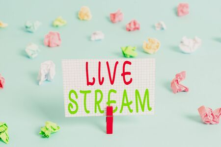Conceptual hand writing showing Live Stream. Concept meaning transmit or receive video and audio coverage over Internet Colored clothespin rectangle shaped paper blue background Stock Photo