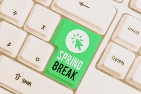 Writing note showing Spring Break. Business concept for Vacation period at school and universities during spring White pc keyboard with note paper above the white background