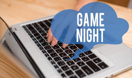 Conceptual hand writing showing Game Night. Concept meaning event in which folks get together for the purpose of getting laid woman with laptop smartphone and office supplies technology