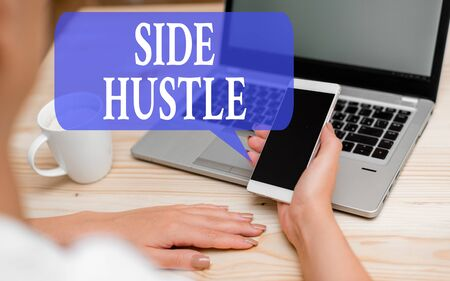 Word writing text Side Hustle. Business photo showcasing way make some extra cash that allows you flexibility to pursue woman laptop computer smartphone mug office supplies technological devices