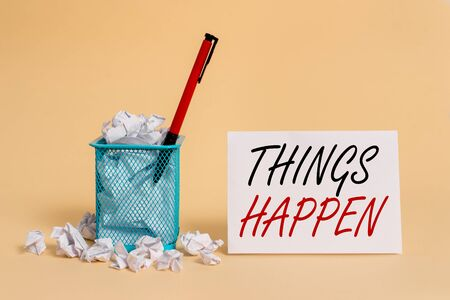 Text sign showing Things Happen. Business photo showcasing Result of situation Course of action Something cannot control crumpled paper trash and stationary with note paper placed in the trash can