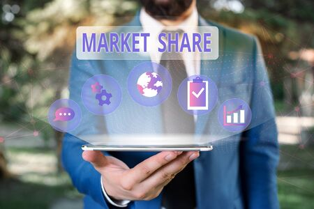 Handwriting text Market Share. Conceptual photo The portion of a market controlled by a particular company Male human wear formal work suit presenting presentation using smart device
