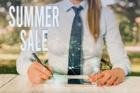Conceptual hand writing showing Summer Sale. Concept meaning Annual discount events that takes place during summer season Female human wear formal work suit presenting smart device 写真素材