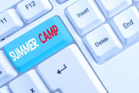 Handwriting text writing Summer Camp. Conceptual photo Supervised program for kids and teenagers during summertime. White pc keyboard with empty note paper above white background key copy space