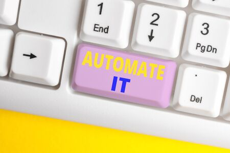 Handwriting text Automate It. Conceptual photo convert process or facility to be operated automatic equipment. White pc keyboard with empty note paper above white background key copy space