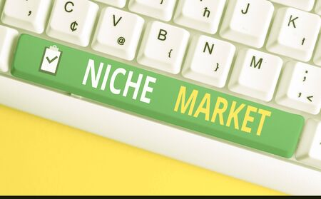 Handwriting text writing Niche Market. Conceptual photo Subset of the market on which specific product is focused White pc keyboard with empty note paper above white background key copy space