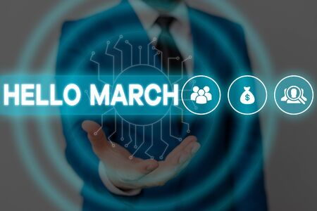 Text sign showing Hello March. Business photo showcasing musical composition usually in duple or quadruple with beat Male human wear formal work suit presenting presentation using smart device
