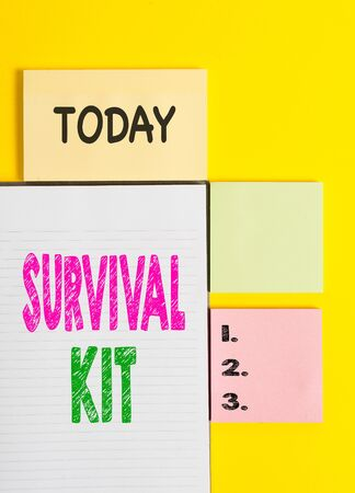 Word writing text Survival Kit. Business photo showcasing Emergency Equipment Collection of items to help someone Colored empty papers with copy space on the yellow background table Stok Fotoğraf