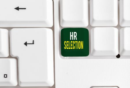 Conceptual hand writing showing Hr Selection. Concept meaning Process and approached by huanalysis resources when hiring employees White pc keyboard with note paper above the white background