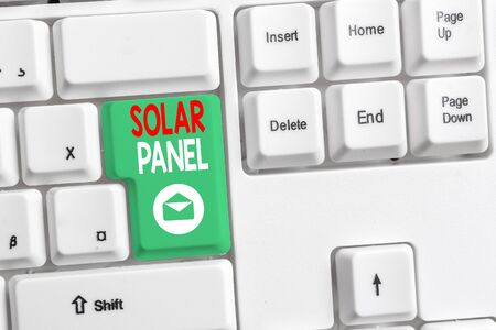 Word writing text Solar Panel. Business photo showcasing designed to absorb suns rays source of energy generating White pc keyboard with empty note paper above white background key copy space