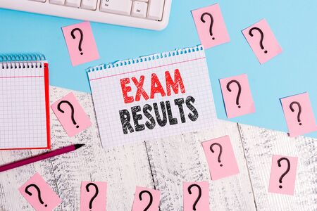 Text sign showing Exam Results. Business photo showcasing An outcome of a formal test that shows knowledge or ability Writing tools, computer stuff and math book sheet on top of wooden table