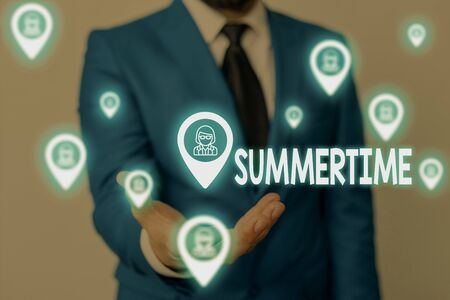 Handwriting text Summertime. Conceptual photo Longer daylight Tropical season Beach activities Vacation Male human wear formal work suit presenting presentation using smart device