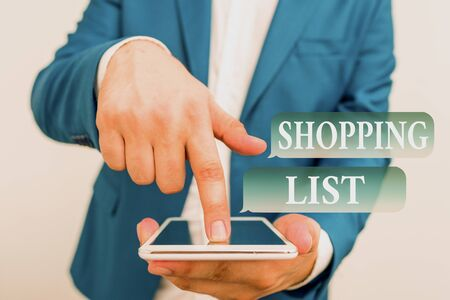 Text sign showing Shopping List. Business photo showcasing Discipline approach to shopping Basic Items to Buy Businessman in the blue suite with lap top pointing with finger