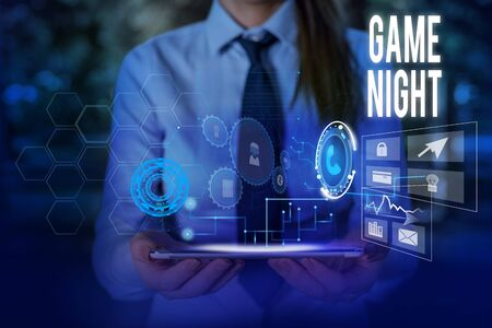 Writing note showing Game Night. Business concept for event in which folks get together for the purpose of getting laid Woman wear formal work suit presenting presentation using smart device Banco de Imagens