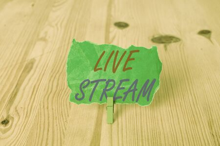 Text sign showing Live Stream. Business photo showcasing transmit or receive video and audio coverage over Internet Empty reminder wooden floor background green clothespin groove slot office