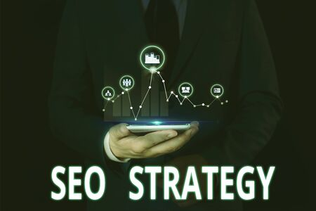 Text sign showing Seo Strategy. Business photo showcasing Techniques and tactics to increase the visitors of a website Male human wear formal work suit presenting presentation using smart device