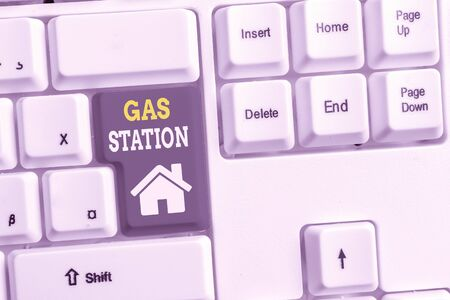 Text sign showing Gas Station. Business photo showcasing for servicing motor vehicles especially with gasoline and oil White pc keyboard with empty note paper above white background key copy space Reklamní fotografie