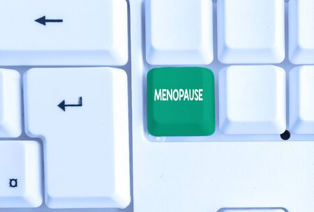 Conceptual hand writing showing Menopause. Concept meaning Period of peranalysisent cessation or end of menstruation cycle White pc keyboard with note paper above the white background