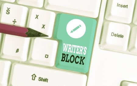 Word writing text Writer S Block. Business photo showcasing Condition of being unable to think of what to write White pc keyboard with empty note paper above white background key copy space